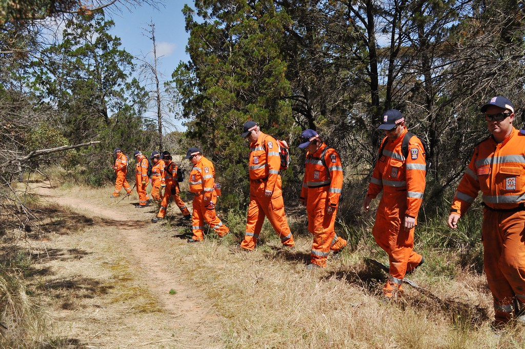 SES volunteers assist with a land search