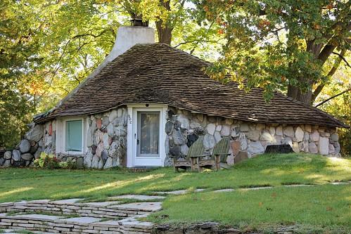 gnomehome hobbithouse storybookstyle boulder rock cedarshake cedar cottage unique unusual earlyoung architect stonehouse mushroomhouse lakemichigan charlevoix michigan jannagalski jannagal