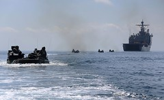 In this file photo, amphibious assault vehicles depart USS Comstock (LSD 45) during a previous exercise in U.S. 7th Fleet. (USMC/Sgt. Melissa Wenger)