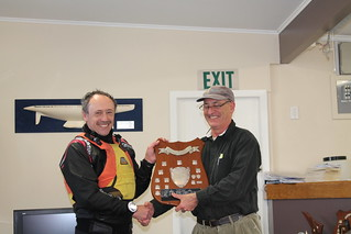 Jeff Coffin, winner of the Senior Handicap Series being presented the Webster Shield by Will Perry   by PLSC (Panmure Lagoon Sailing Club)