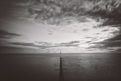 longexposure sky blackandwhite bw lake water clouds blackwhite dusk birdhouse mandeville causeway breakwall sunsetpoint lakepontchartrain ef1740mmf40l 5dmarkiii tyalexanderphotography northshorecanon