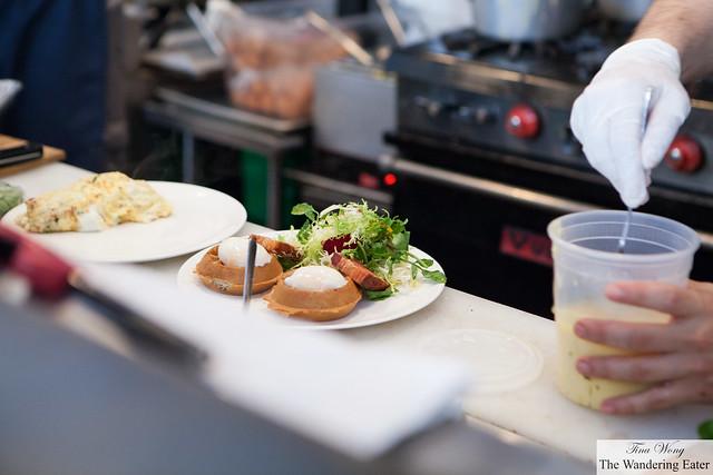 Peering in the open kitchen - plating Waffles Benedict