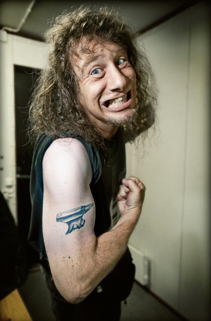 Steve Lips Kudlow Showing His Anvil Tattoo Sauna Open A