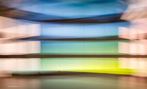 Long shutter exposure  of a hall way from a moving escalator - O'Hare Airport- Chicago | by Phil Marion (173 million views - THANKS)