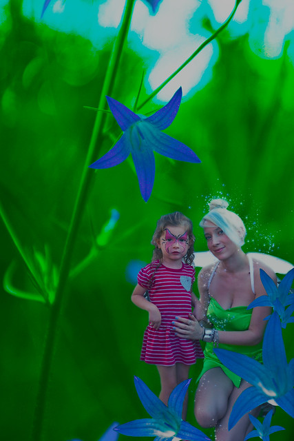 Tinkerbell between blue flowers