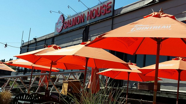 Ivan 's Salmon House Sign under bright umbrellas, North Lake Union, Seattle, Washington, USA
