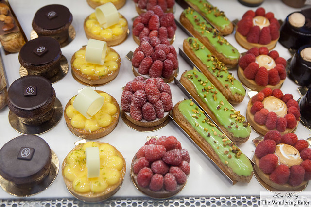 Cakes from left to right: Mi-Cut, Yuzu Tart, Raspberry Tarts, Pistachio eclairs, Lemon meringue and raspberry tarts