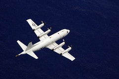 In this file photo, a P-3C Orion from Patrol Squadron 40 flies a mission in August during GUAMEX 2014, a multilateral anti-submarine warfare exercise to enhance interoperability and strengthen personnel ties between the U.S. Navy, Japan Maritime Self-Defense Force, Royal Australian Air Force and Royal New Zealand Air Force. (U.S. Navy/MC2 Jillian Lotti)