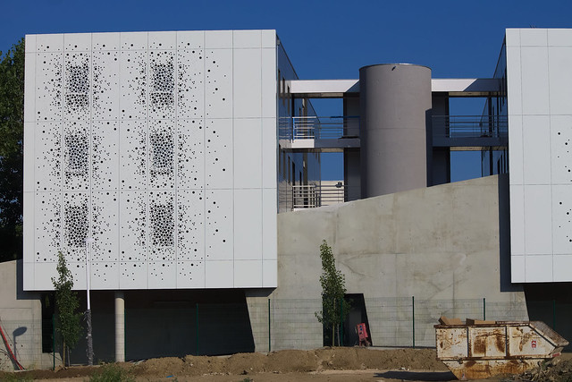 New office building with perforations in the wall