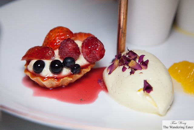 Berry tartlette and vanilla chantilly with dried rose petals