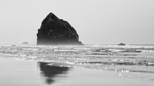 blackandwhite seascape seastack cannonbeach oregon pacificnorthwest pacificocean ocean water pnw shore beach bokeh depthoffield dof outdoors contrast canoneos5dmarkiii canon135mmf2lusm monochrome