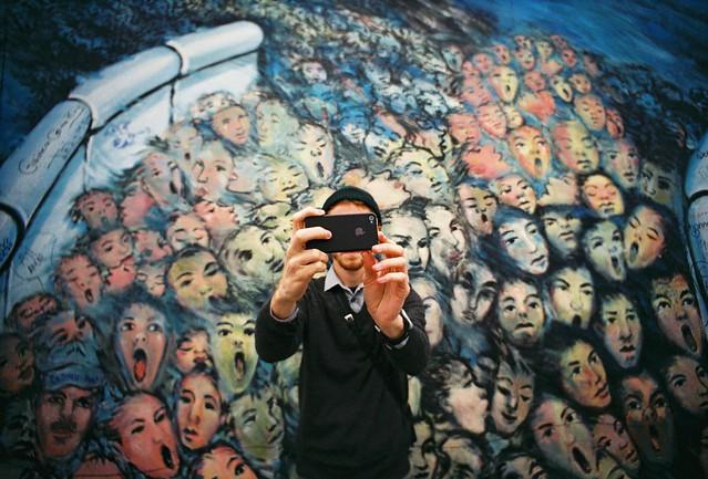 Jake taking a selfie. East Berlin Wall.