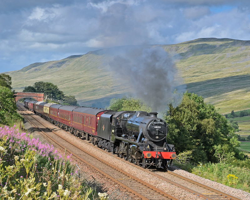 8F 48151 climbs through Mallerstang  with the southbound Fellsman train of Aug.6th 2014. Mallerstang Edge and the 2300ft top of High Seat form the background.