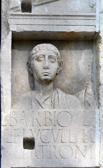 Left side of the tombstone of the Roman Barbius