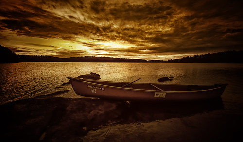 sunset ontario canada water clouds golden canoe silentlake