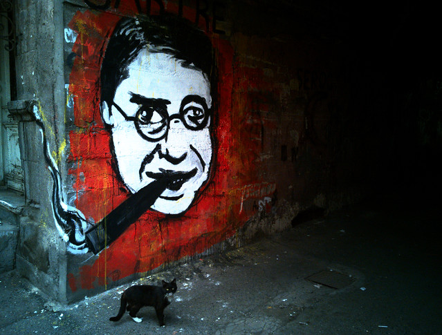 Sartre graffiti and cat.