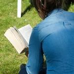 Reading on the grass at the Edinburgh International Book Festival |