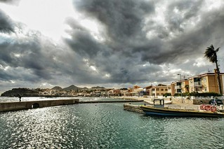 """A hook can only catch a fish when it is in the water""  This lone fisherman risks a soaking as rain laden storm clouds loom overhead in the pretty harbour of the fishing town Cabo de Palos #mustseemurcia   We were sat in the warm, comfortable and most of 