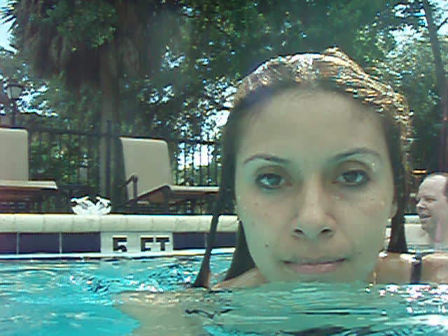 Part 3 of Marisol swimming around holding the camera taking video of herself