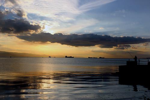 sunset sea fisherman seashore