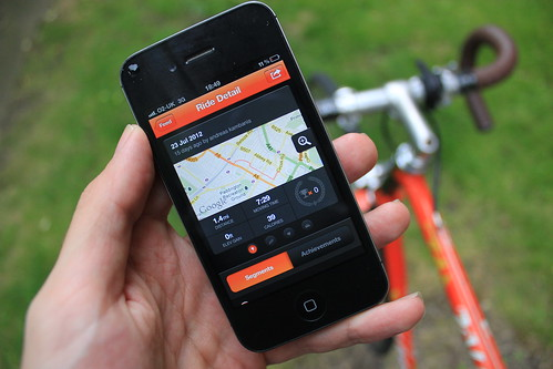 The Strava app shown on an iPhone with a bike behind | by londoncyclist