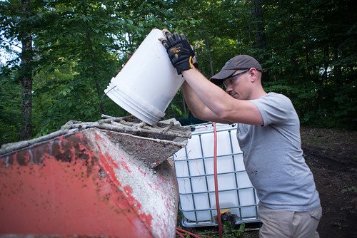 Kevin Pouring Sand into Mortar Mixer | by goingslowly
