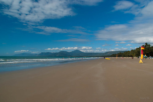 trees sea sky people beach water clouds reflections palms flags hills queensland portdouglas mountians austraila