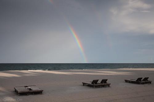 ocean beach rainbow florida deckchairs
