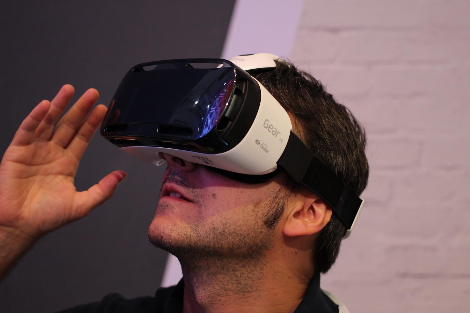 A man wearing a Gear VR headset