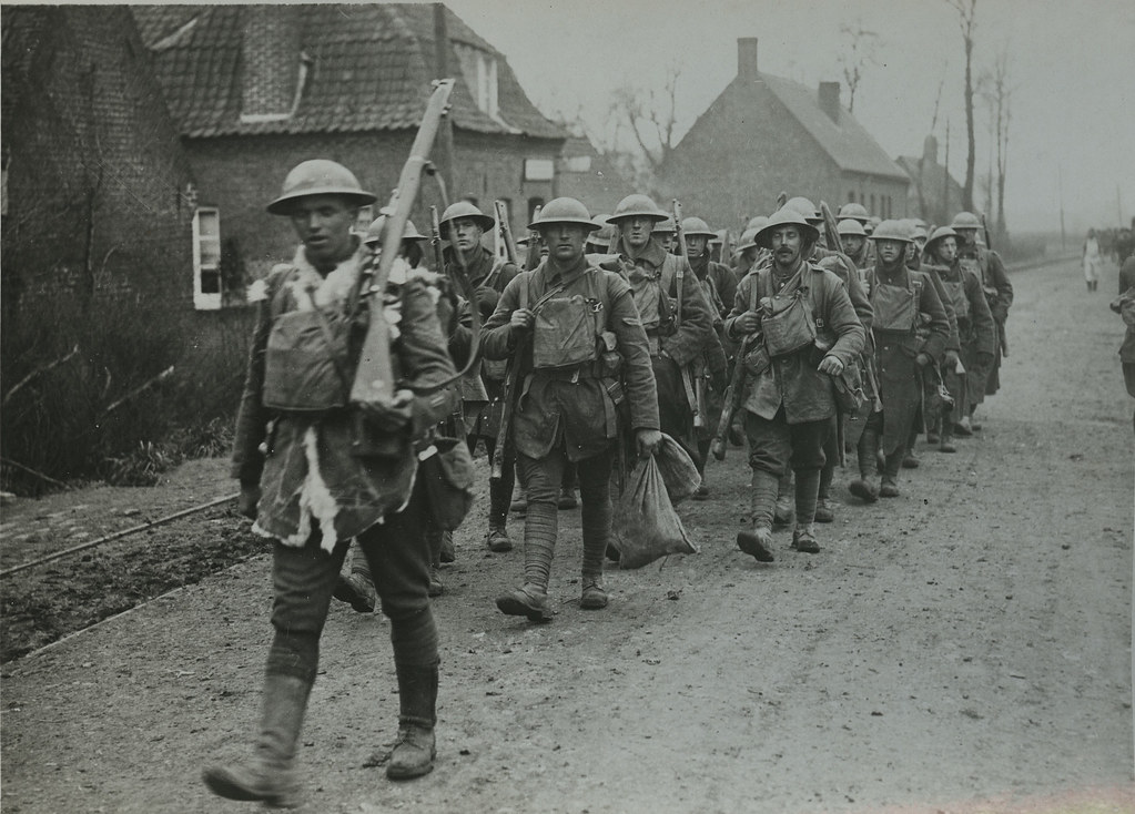 Official photograph taken on the British Western Front in France : The German offensive - Some of the gallant 55th going for a short rest after fighting hard