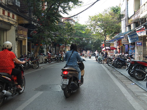 Motorcycles on a street in the Hanoi old quarter | by shankar s.