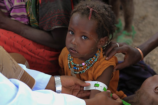 Aysha Nur a mother of four is receiving a medical treatment for her child | by UNICEF Ethiopia