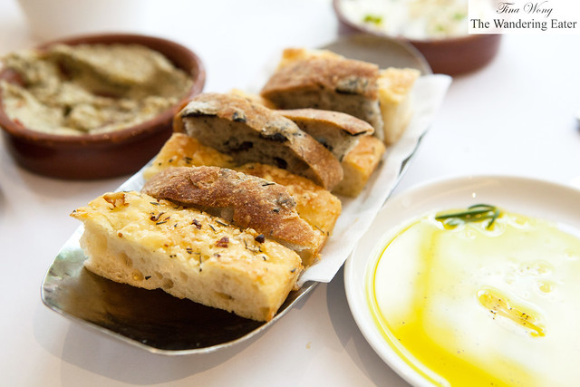 Sliced housemade foccacia and olive bread