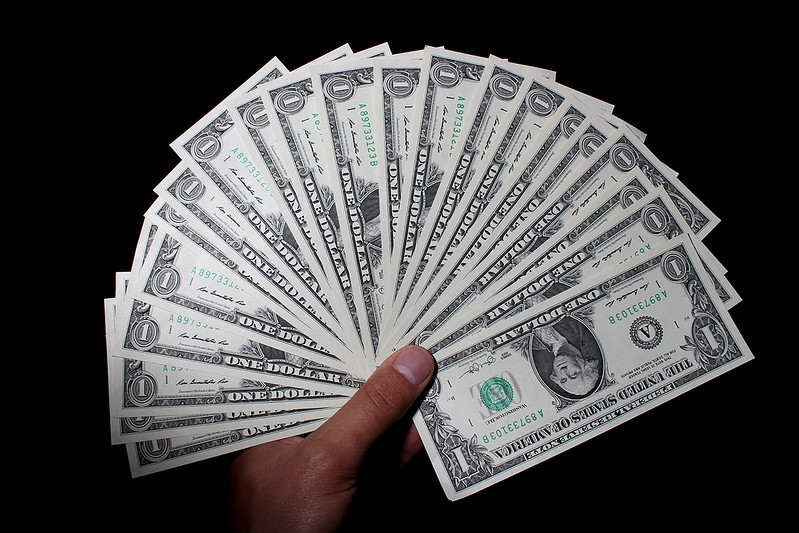 Holding money in hands