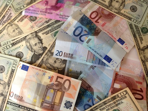 US dollars and Euros - cash banknotes | by Mark Hodson Photos
