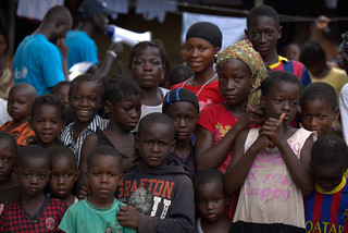 Children of Matam, Conakry listen to UNICEF explain the current outbreak of Ebola and the ways to stop the spread | by unicefguinea