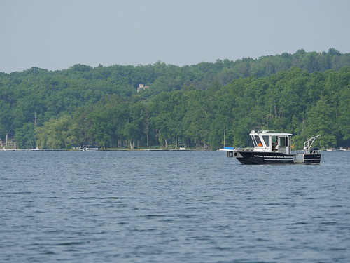 Photo of Deep Creek Lake, with Maryland Department of Natural Resources research boat taking biological samples
