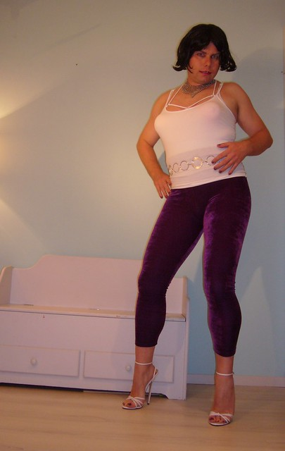 purple leggings and white stiletto heels