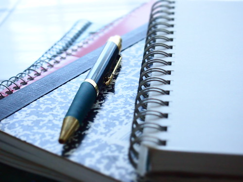 Notebooks and Green Pen | by Leslie Richards