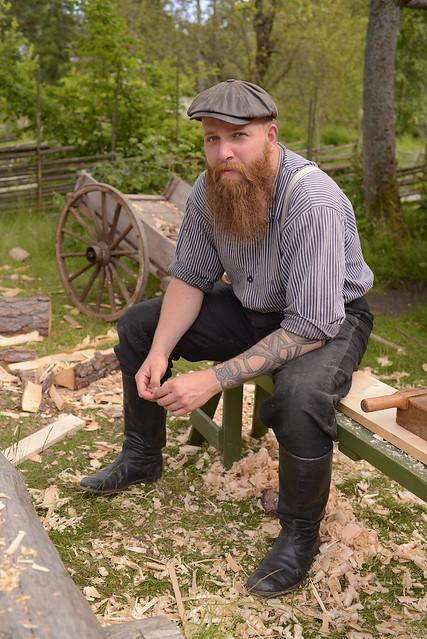 A carpenter behind his beard.