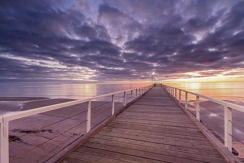 sunset clouds reflections pier jetty