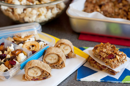 peanut butter banana sushi, oatmeal squares and fruit and nut mix for kid snacks | by PersonalCreations.com