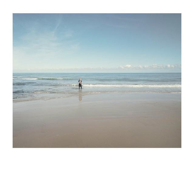 Ned, sea, sand, sky.