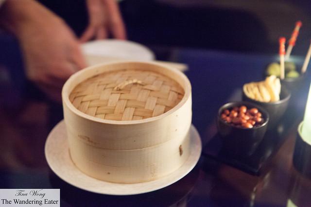 Steamer basket filled with soup dumplings