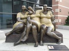three ladies on West 120th Street in Manhattan
