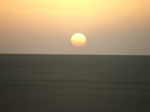 Sahara Desert: The sun sets over the flat, flat desert to the west of our eclipse-viewing site