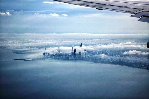 chicago window fog skyline clouds airplane