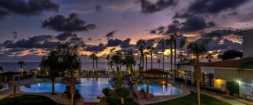 sunset afterglow goldenhour colour paphos cyprus evening twilight beach water sky blue light cloud trees landscape
