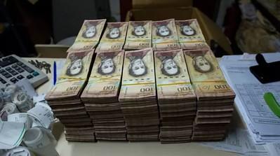 Business News: Venezuela struggles, Tame Triple-Digit Inflation