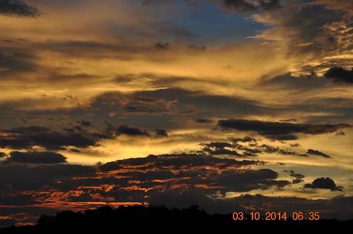 pink blue red orange sun yellow clouds sunrise